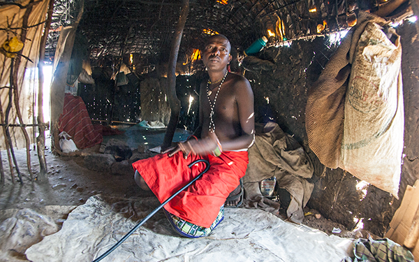 african-male-inside-hut